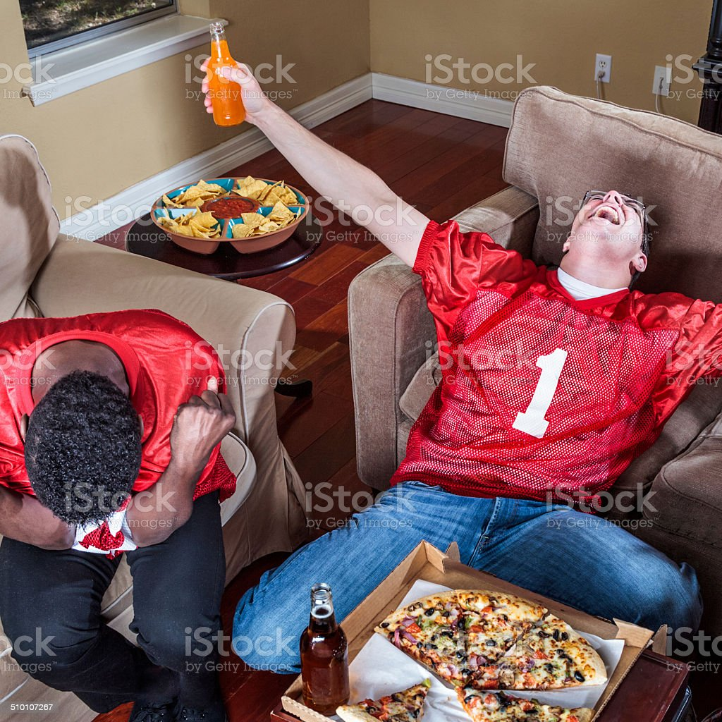 watching TV football,  Ecstasy of Victory and Agony of Defeat stock photo