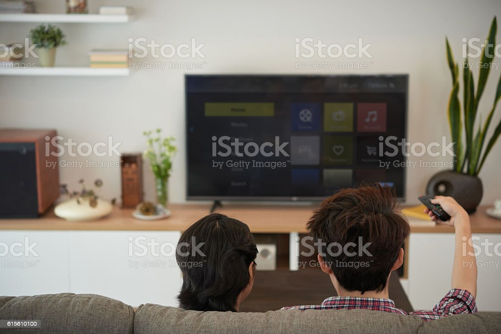 Watching tv shows stock photo