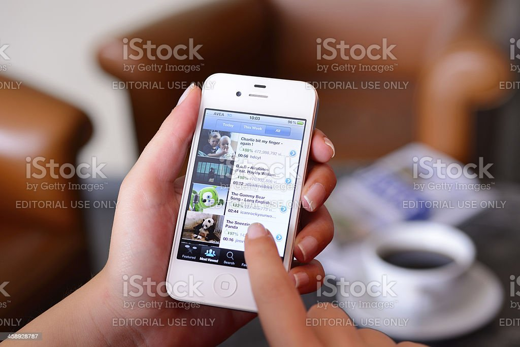 Watching videos on iPhone stock photo
