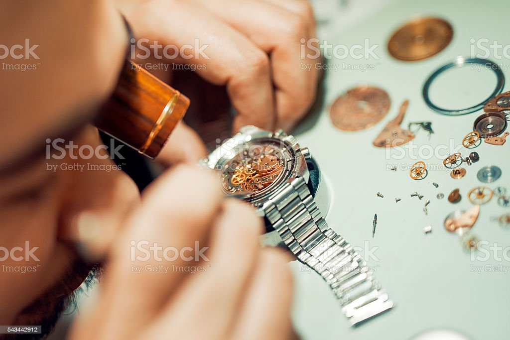 Watchmaker at work stock photo