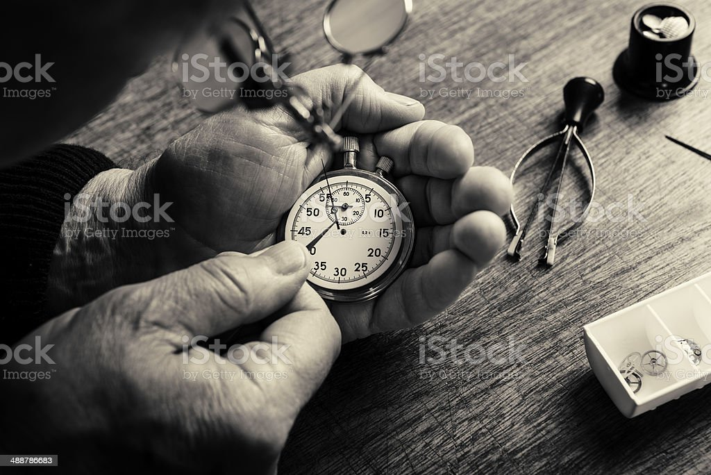 Watchmaker at Work Toned Black and White stock photo