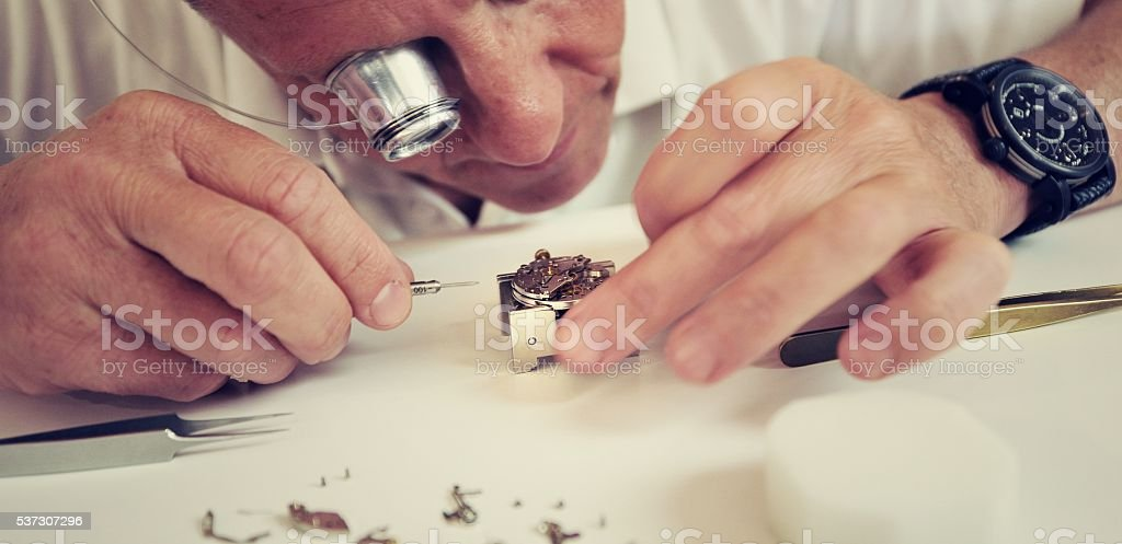 watchmaker making luxury handmade watch stock photo