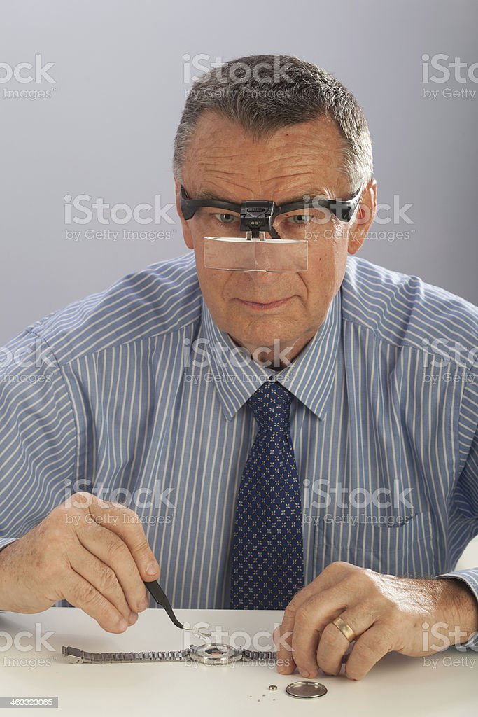 Watchmaker With Glasses royalty-free stock photo