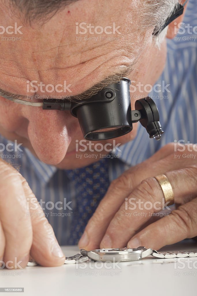 Watchmaker With Magnifying Glasses royalty-free stock photo