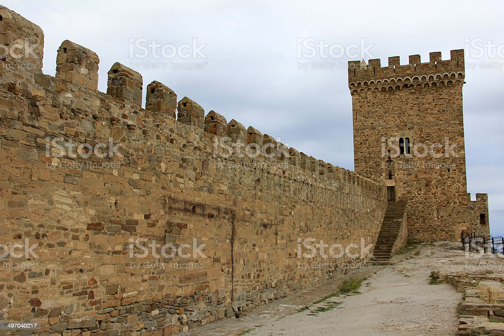 Watchtower and jagged wall of the Genoese fortress in Crimea stock photo