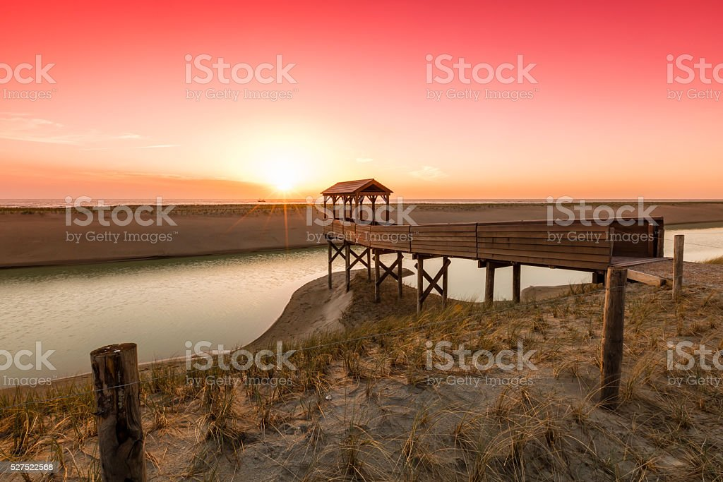 Watchtower At North Sea Dunes During Sunset stock photo