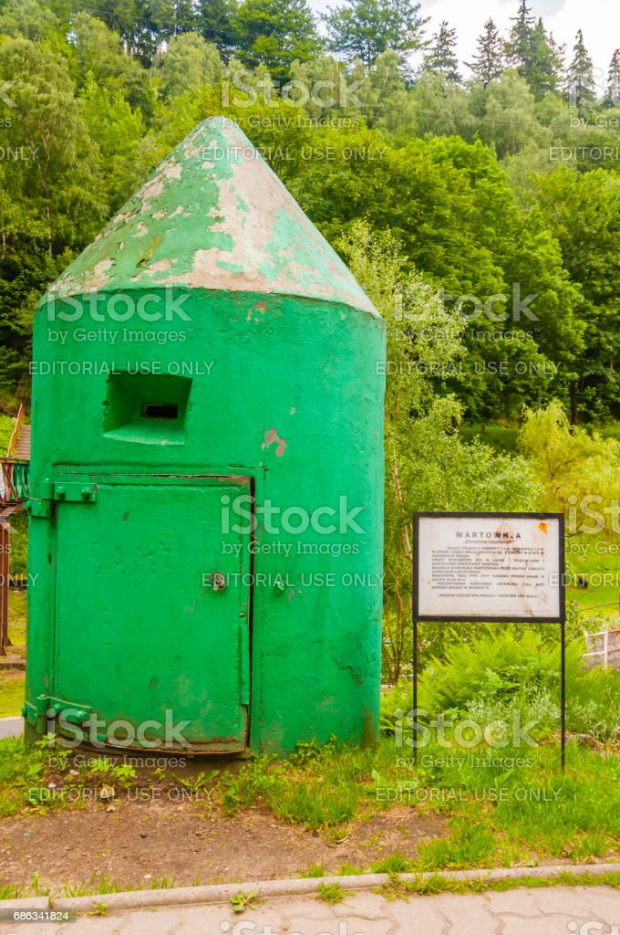 Watchtower in the shape of a roll of reinforced concrete from the Second World War. stock photo