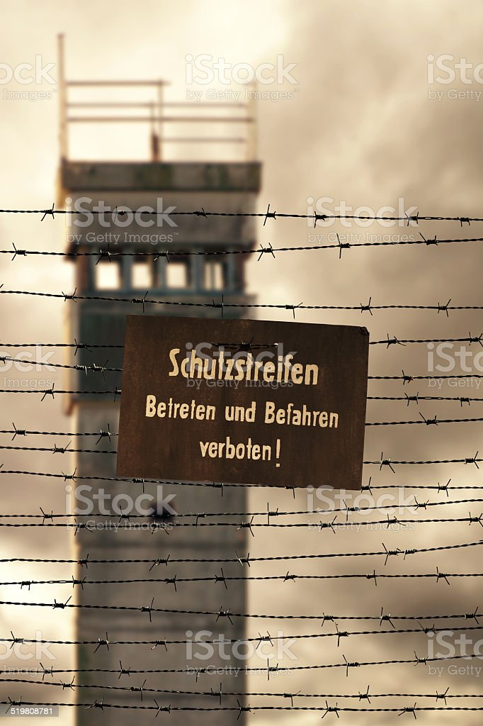 Watchtower with barbed wire and prohibition sign stock photo