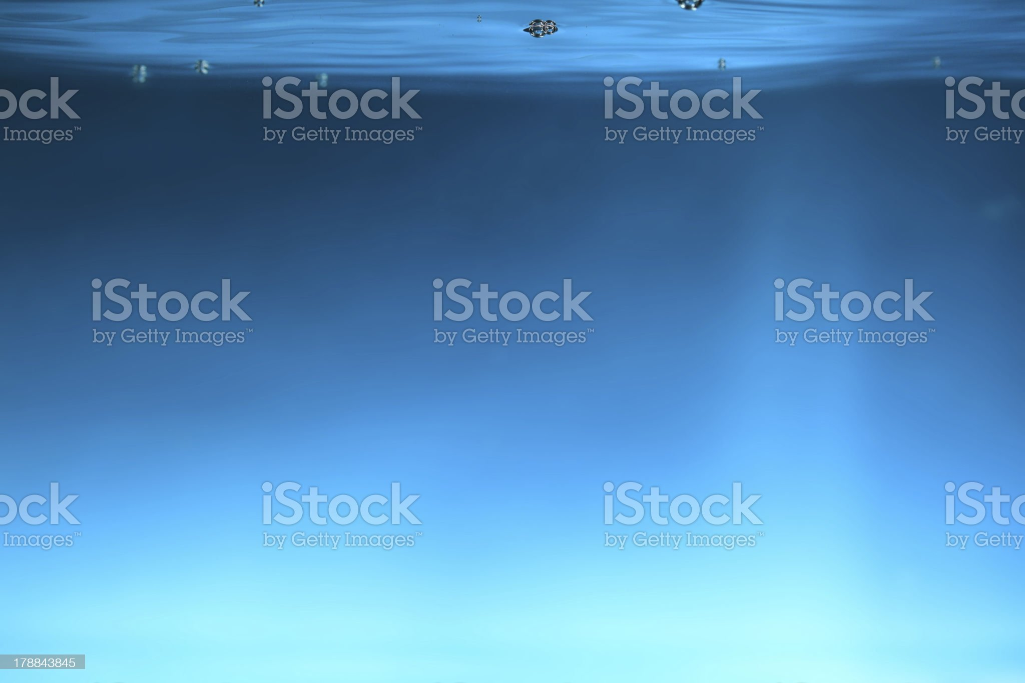 Water and air bubbles over blue background royalty-free stock photo