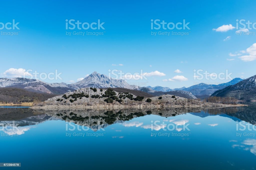 Water and sky mirror, Mountain landscape over the lake stock photo