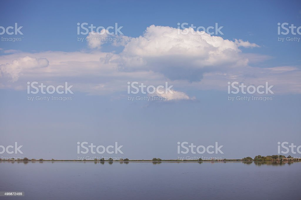 Water and sky with clouds stock photo