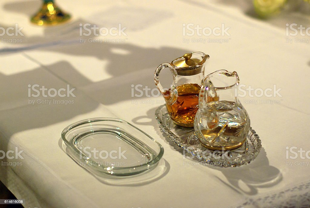 water and wine on the altar ready for Holy Mass stock photo