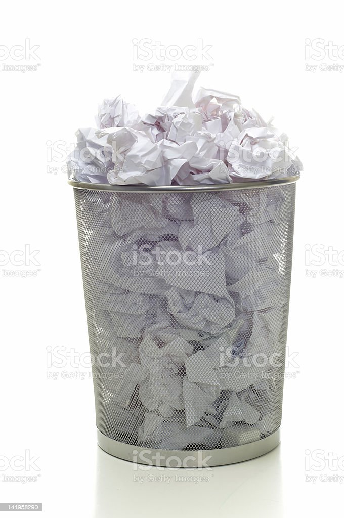 Water basket overflowing with white papers royalty-free stock photo