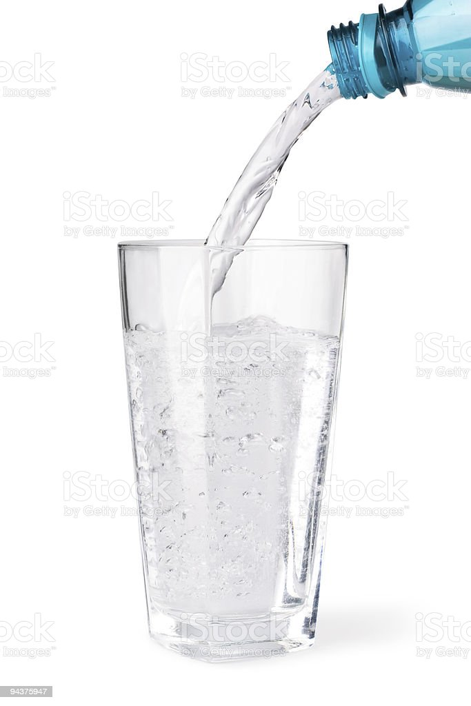 Water being poured into a glass royalty-free stock photo