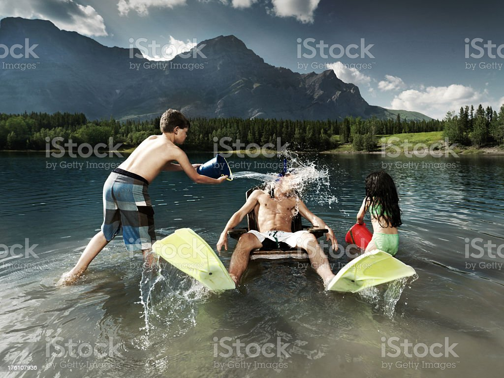 Water being thrown over man royalty-free stock photo