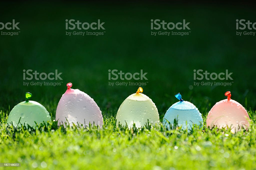Water bombs in a row stock photo