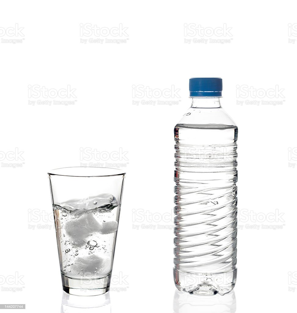 Water bottle and a glass royalty-free stock photo