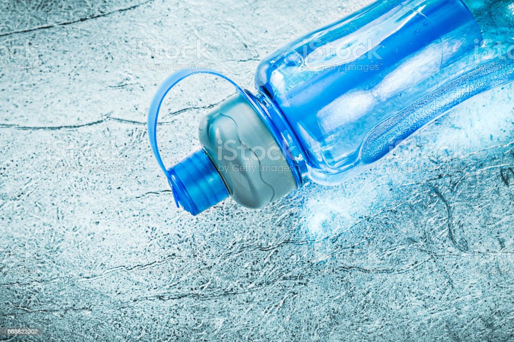 Water bottle for doing sports on silver background fitness conce stock photo
