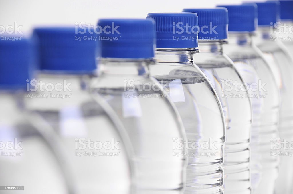 water bottle lids blurred stock photo