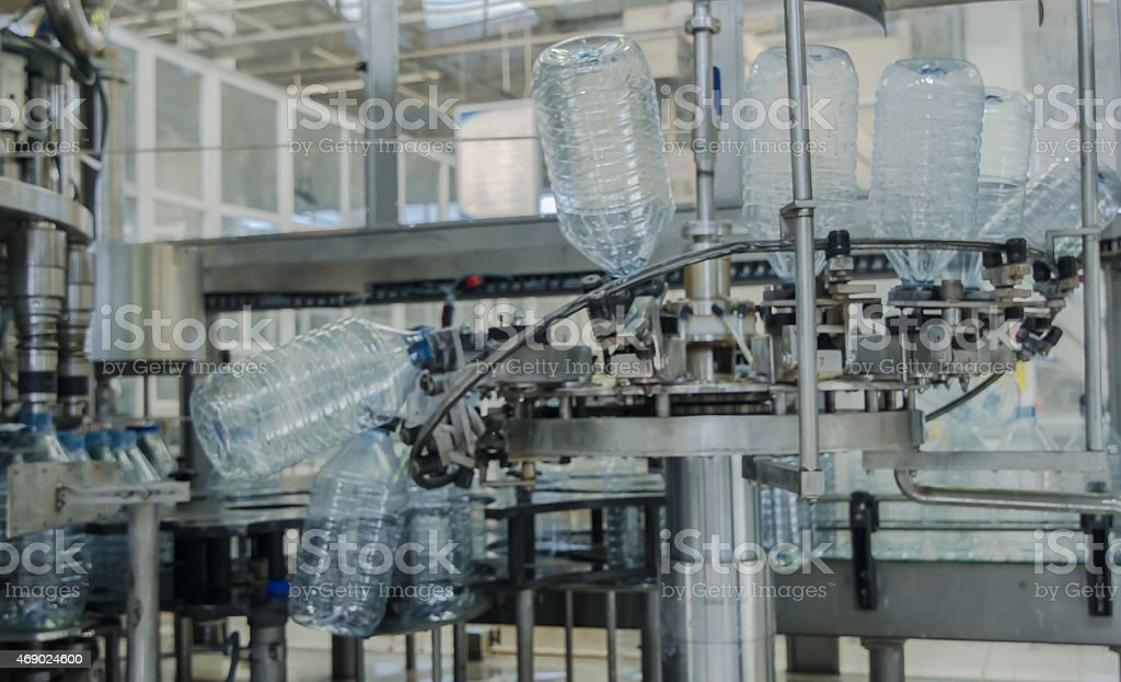Water bottle machine in a factory stock photo