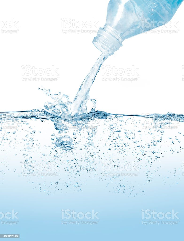 Water bottle pouring against blue background stock photo