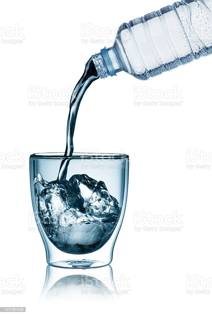 Water bottle pouring into glass royalty-free stock photo