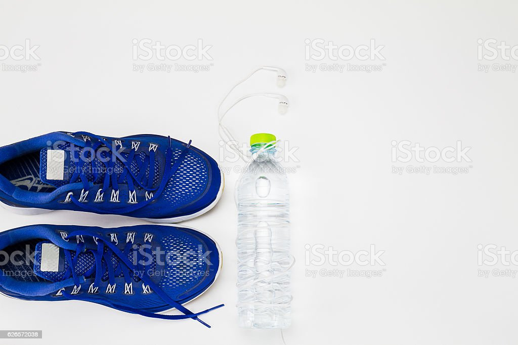 Water bottle, sport shoes, headphone on white background stock photo