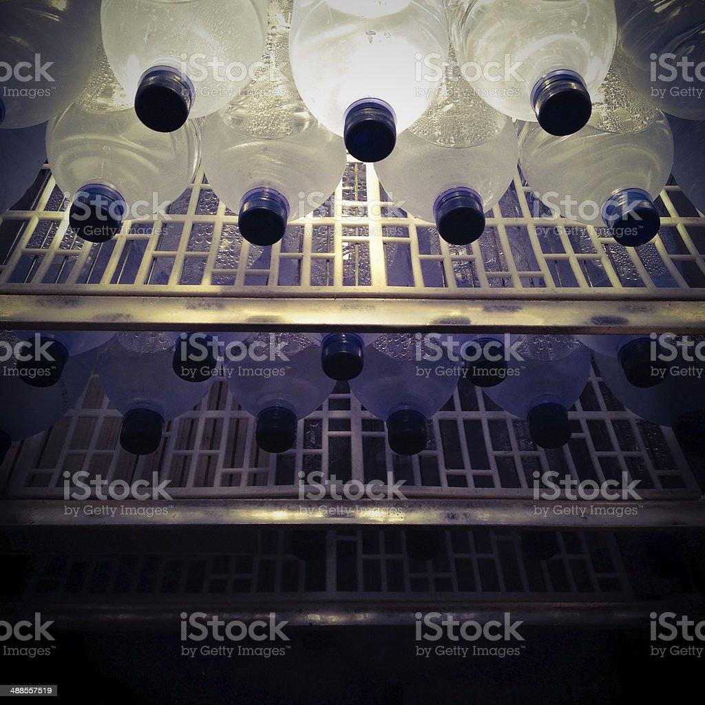 Water bottles inside fridge royalty-free stock photo