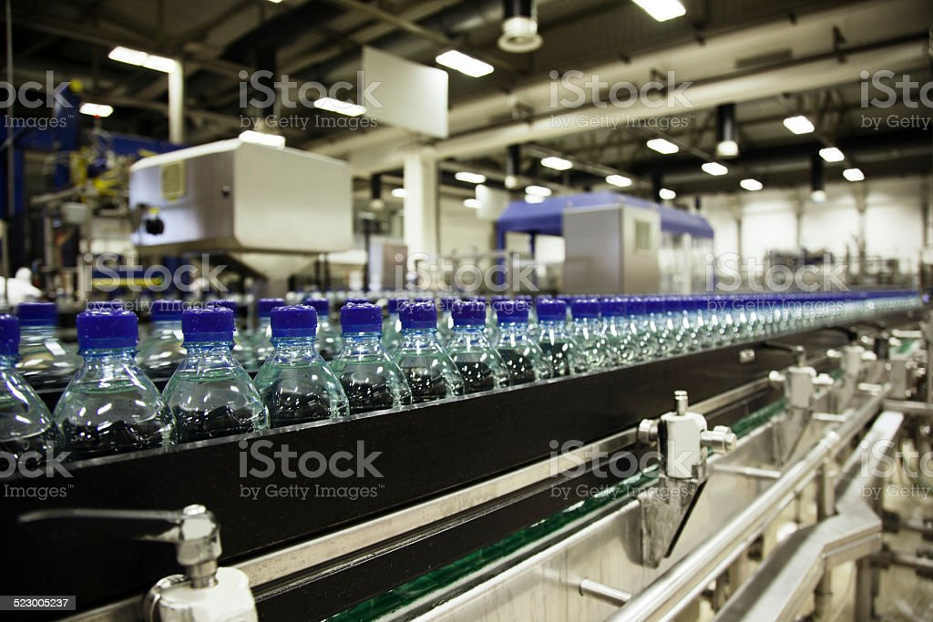 water bottling plant production line stock photo