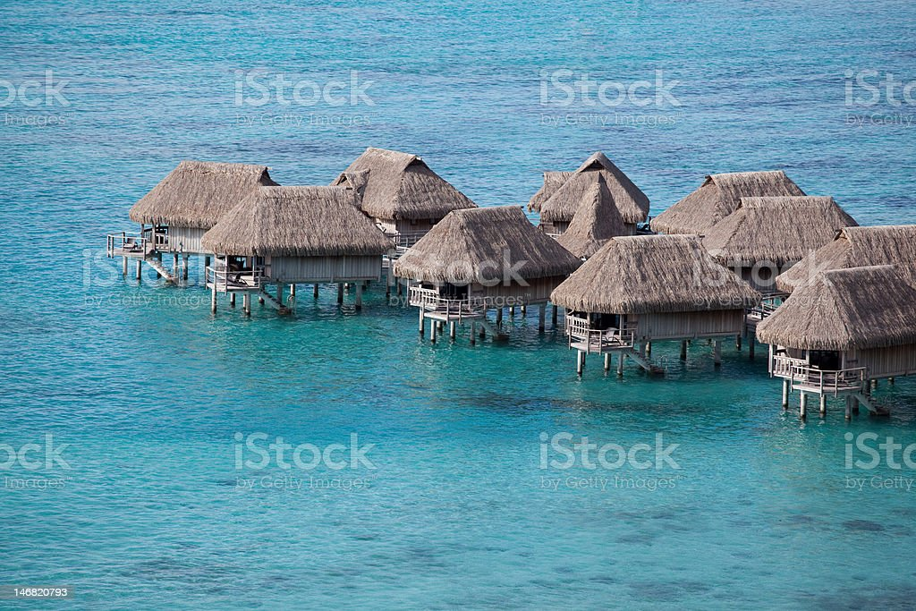 Water bungalows in the lagoon stock photo