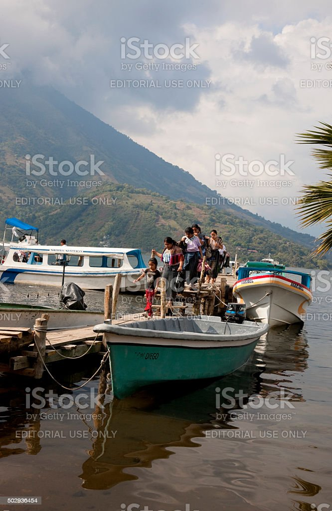 Water buses and taxis on lake Atitlan stock photo