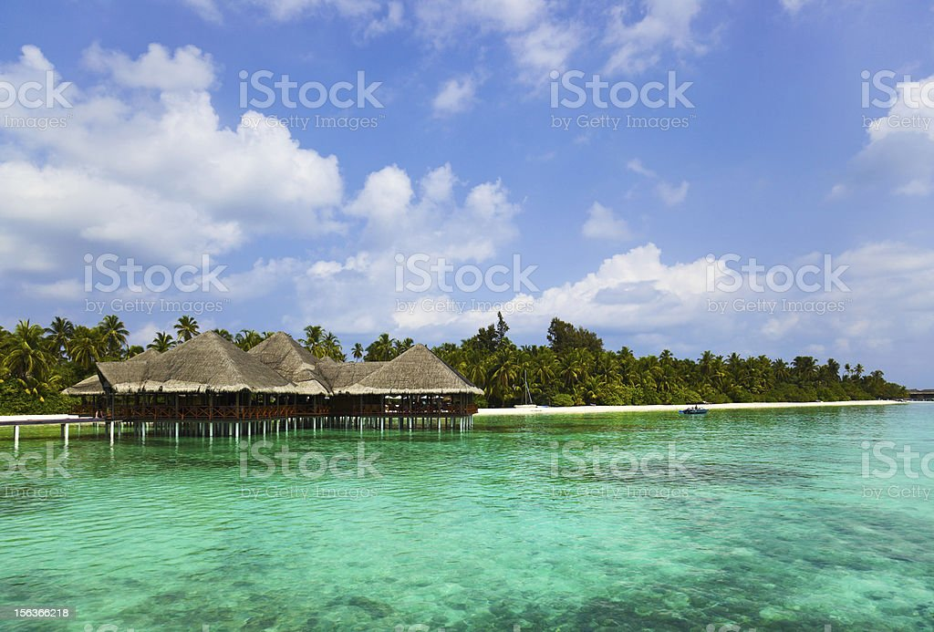 Water cafe on a tropical beach at Maldives royalty-free stock photo