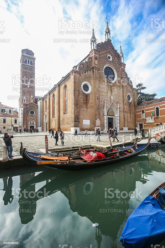 Water canal in front of Basilica dei Frari stock photo