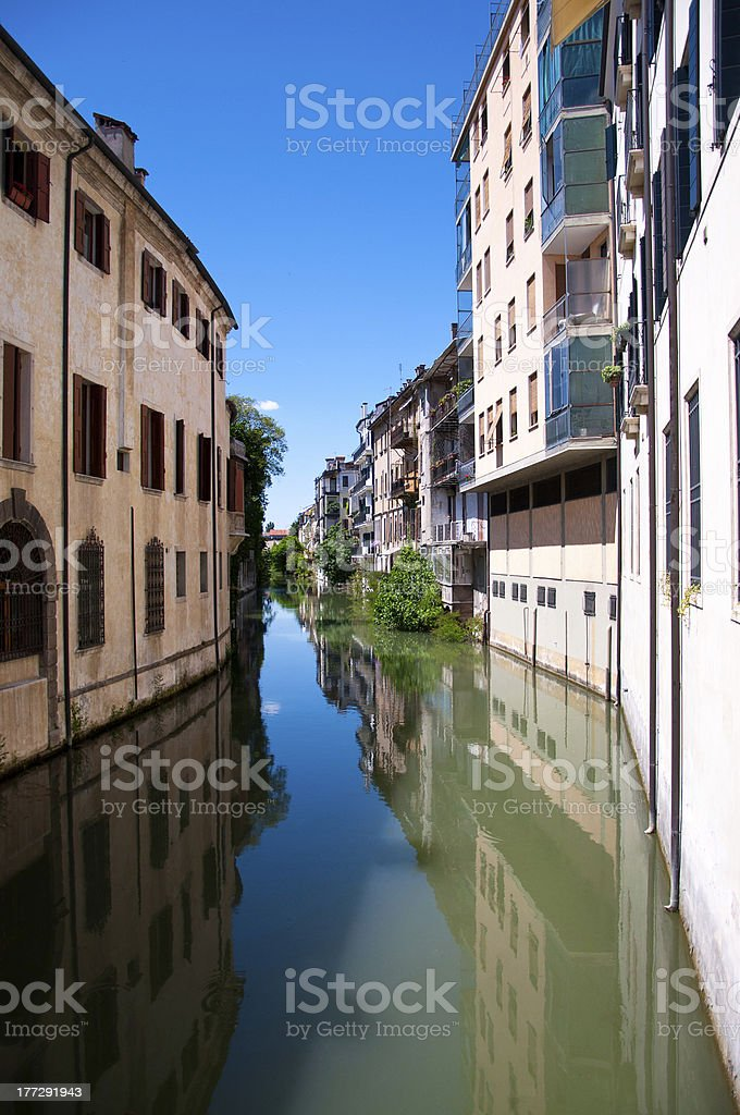 Water canal with reflections in Padova royalty-free stock photo