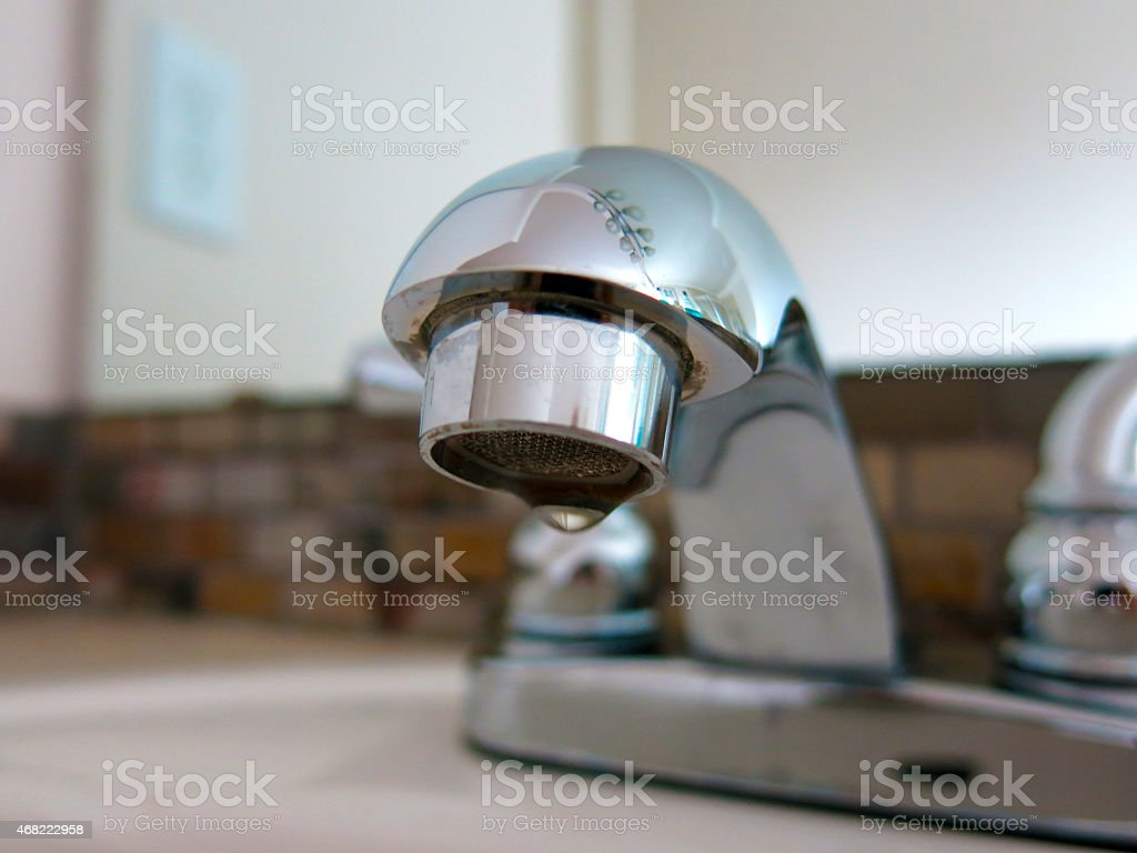 Water conservation faucet stock photo