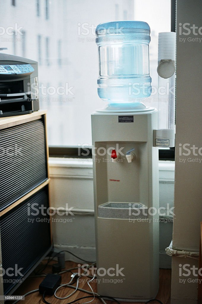 Water Cooler in the Corner of a Small, Messy Office stock photo