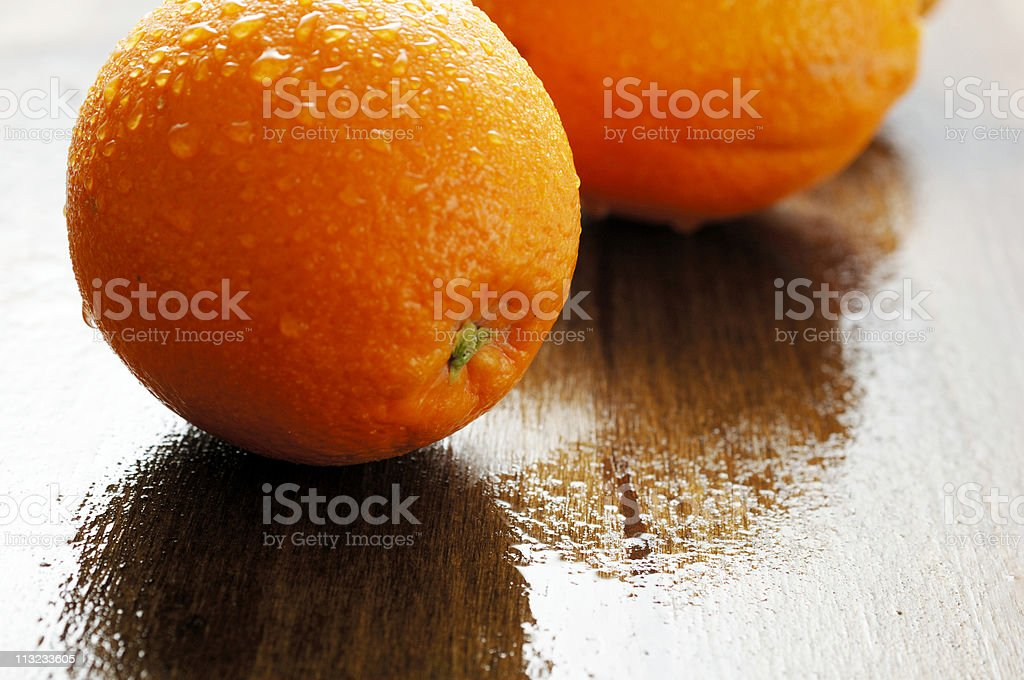water covered ripe citrus oranges with copy space stock photo