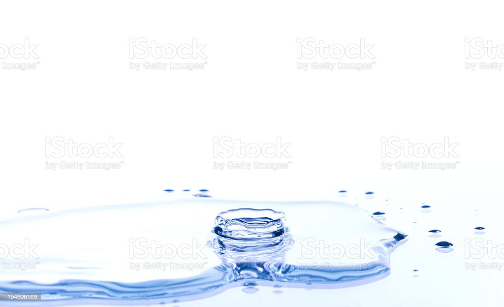 Water Crown Splash on a Reflective Surface stock photo