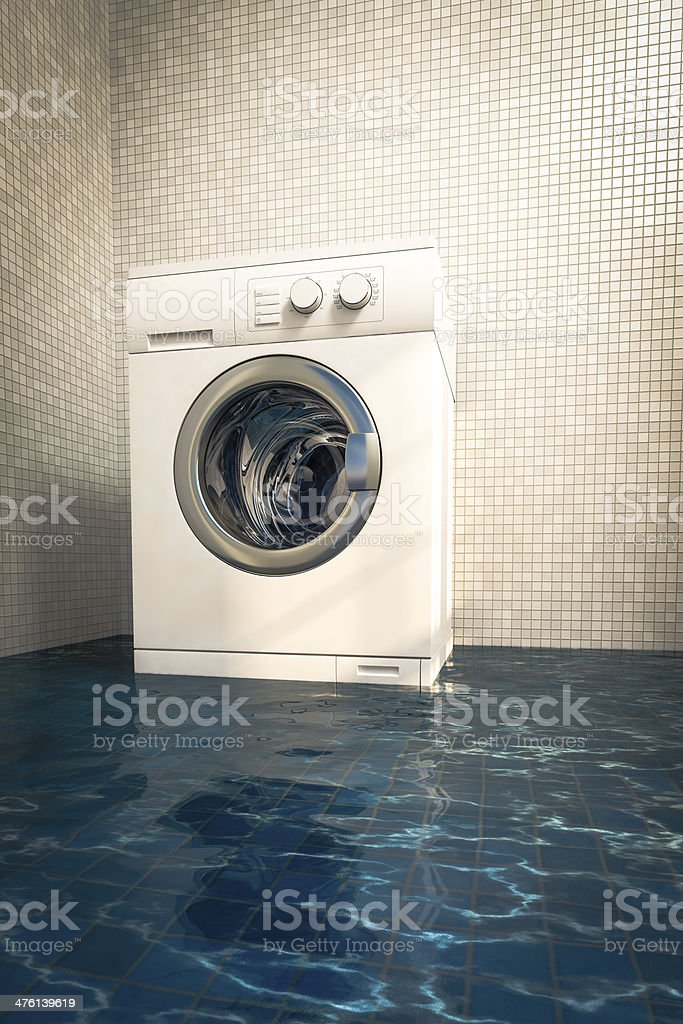 Water damage caused by defective washing machine stock photo