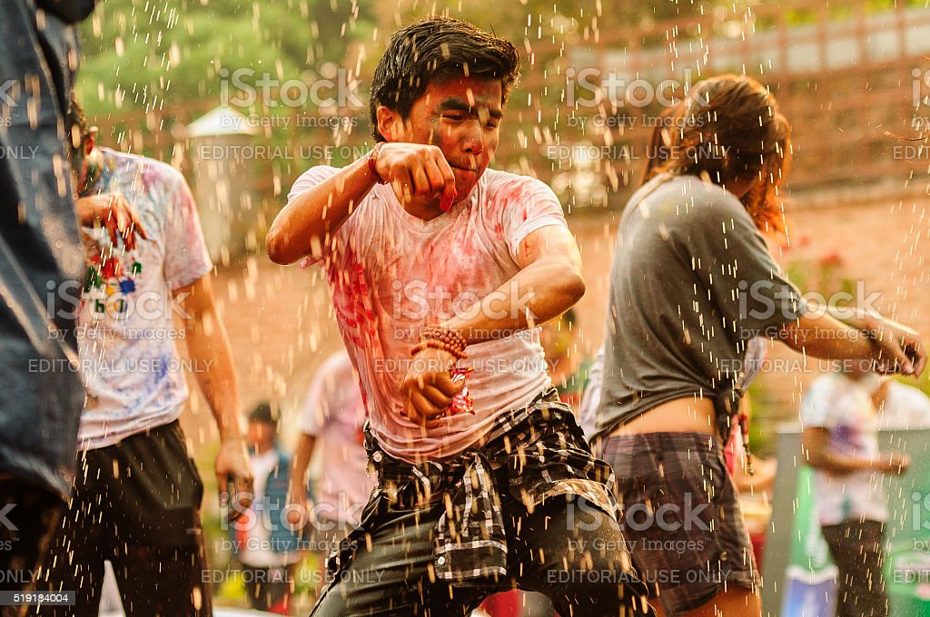 Water dance during Holi, the festival of colors stock photo