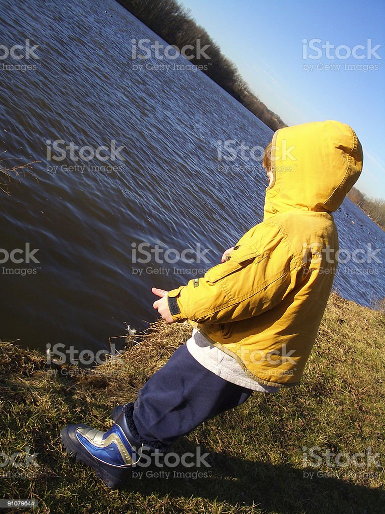 Water Danger Toddler by Grand River in Michigan stock photo