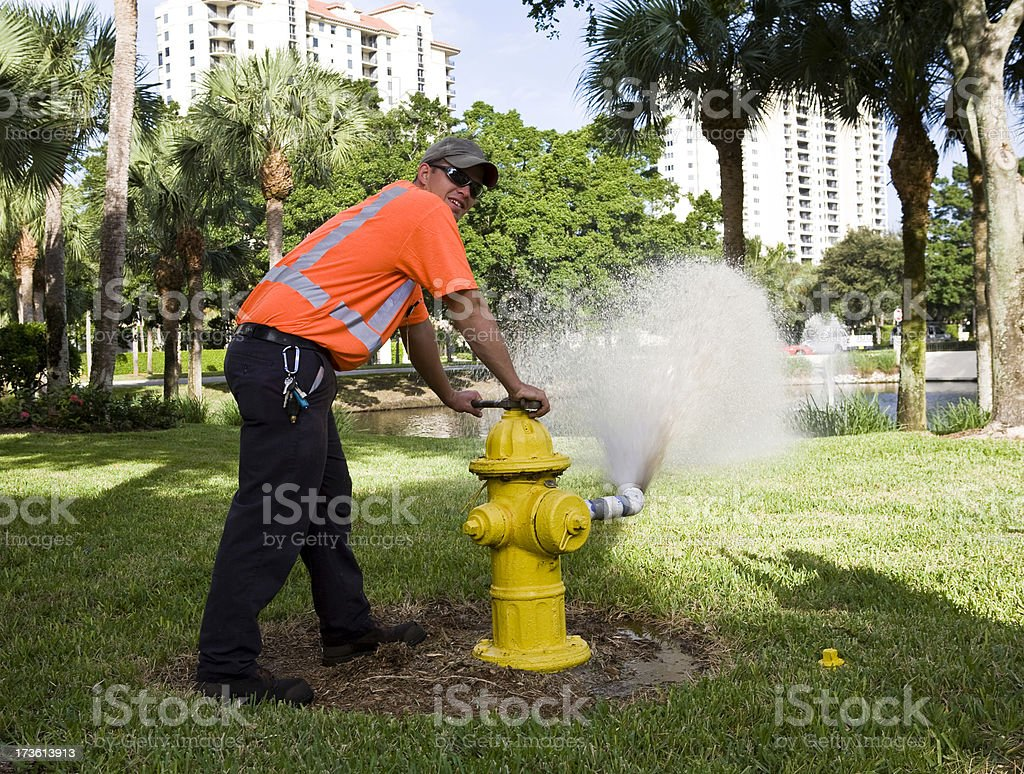 Water Department Field Technician Flushing Hydrant stock photo