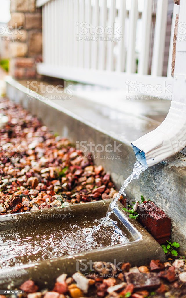 Water Draining From Gutter stock photo