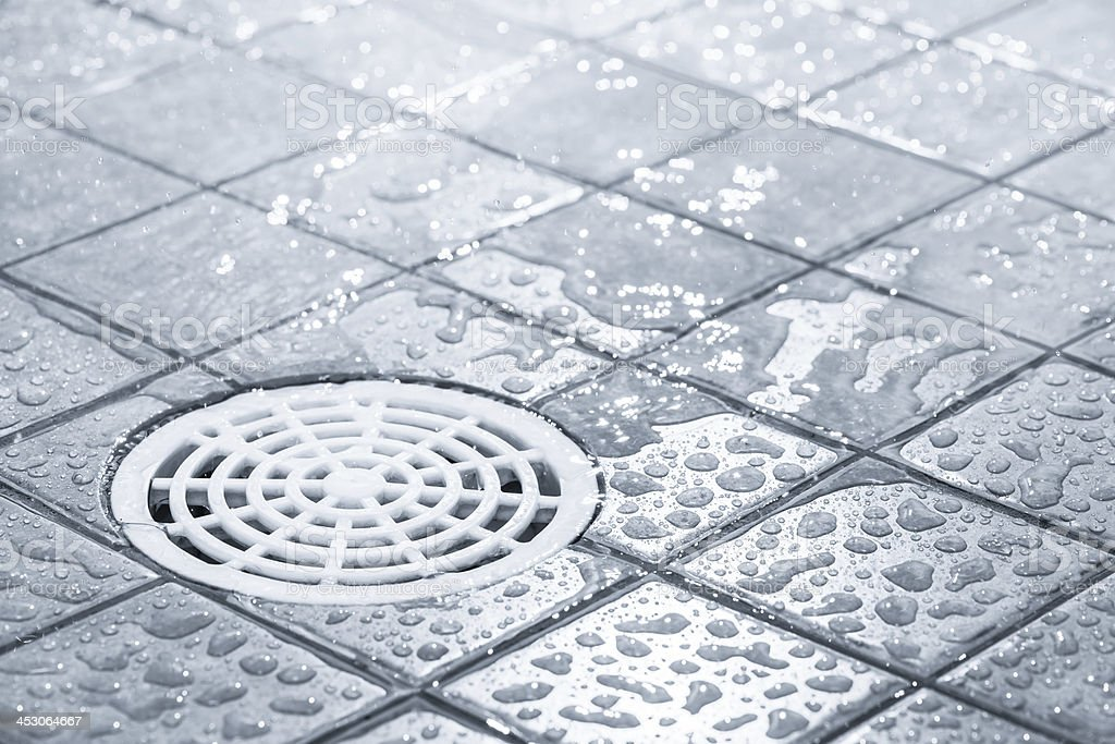 Water draining off after a shower royalty-free stock photo