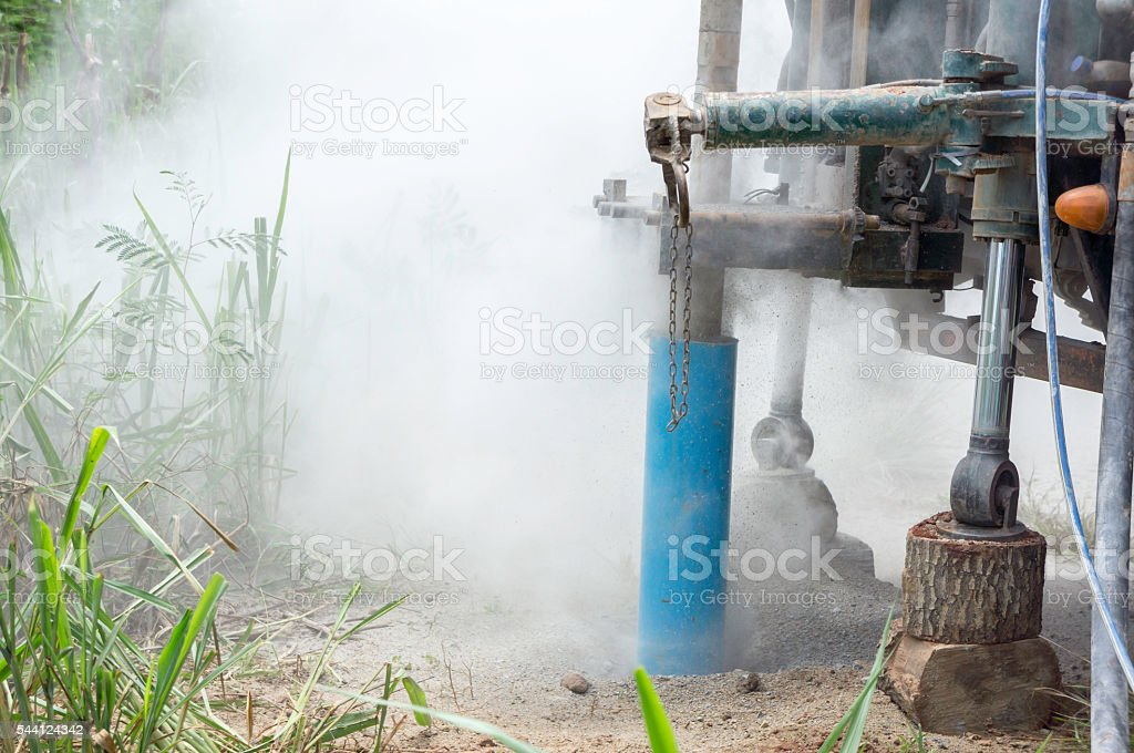Water drilling rigs underground stock photo