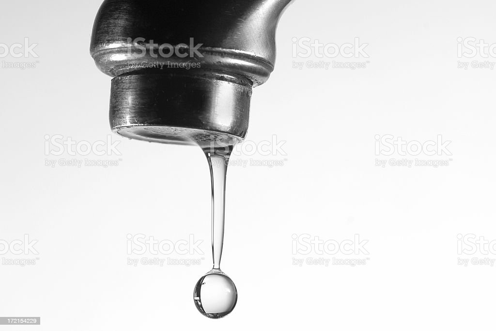 Water drop and the Spigot royalty-free stock photo