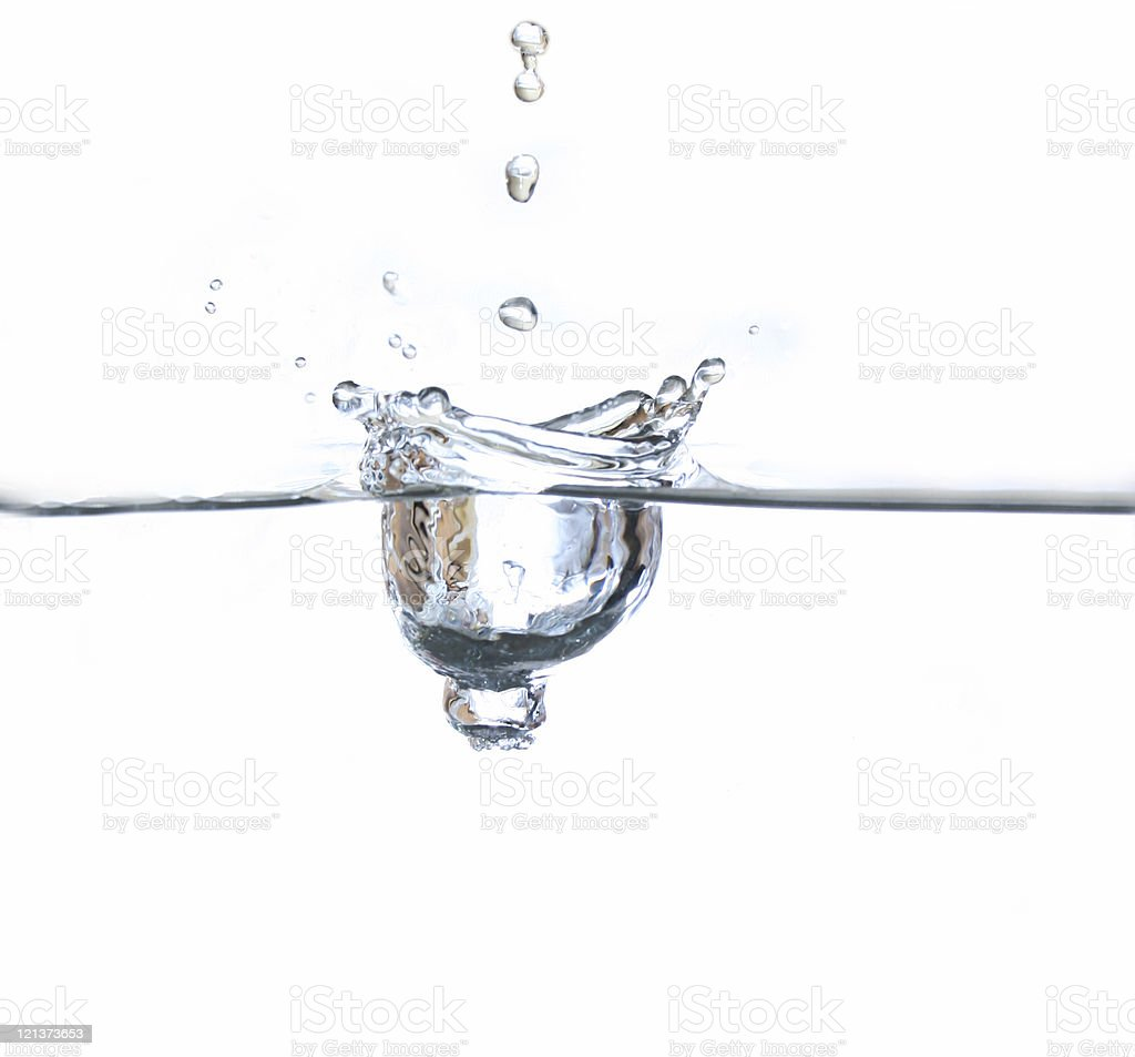 Water drop breaking the surface royalty-free stock photo