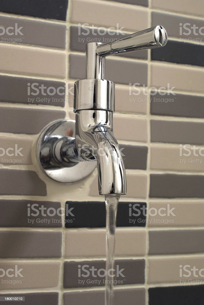 water drop from metal tap royalty-free stock photo