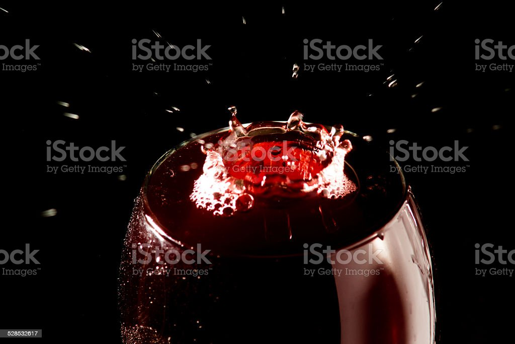Water drop in a wine glass stock photo