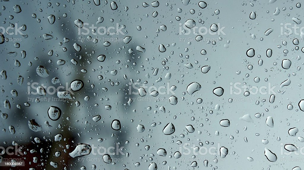Water drop on car glass with electric post as background royalty-free stock photo